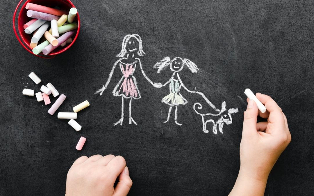 Chalk drawing of a single mom with her child and their family dog
