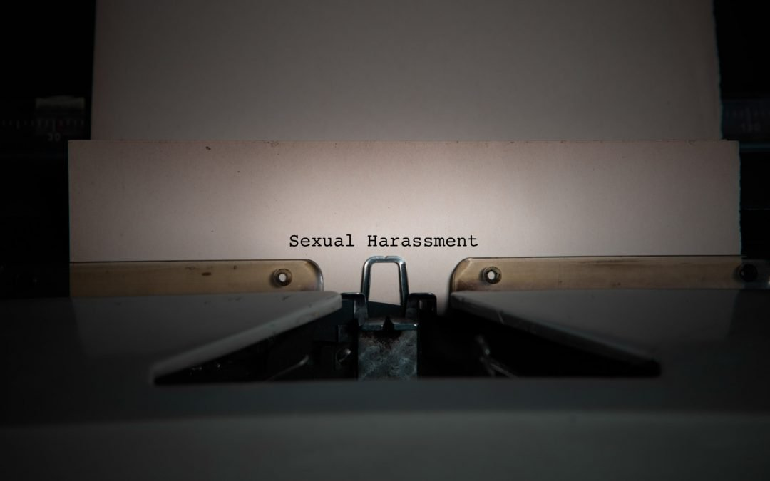 sexual harassment wording on an old typewriter